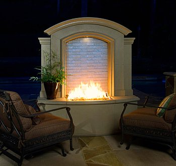 outdoor fireplace with chairs