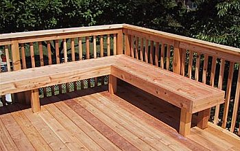 Deck bench in front of railing