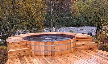 hot tub with wooden surround