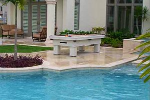 outdoor pool table beside pool