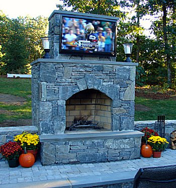 An outdoor tv keeps the fun in the backyard not in the house - Outdoor fireplace with tv ...