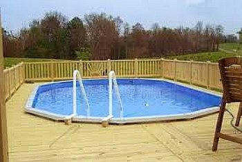 Top above ground pool deck for your backyard for Basic in ground pool designs
